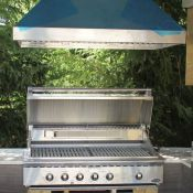 Custom-outdoor-kitchen-range-and-hood